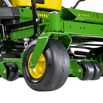 Right mower anti-scalp wheel and center rollers