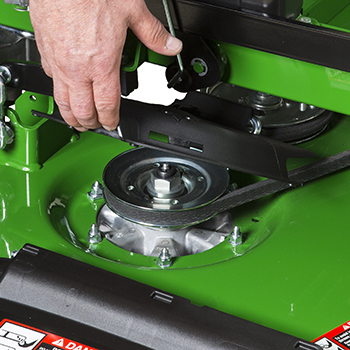 Flip-up spindle cover for easy cleanout and maintenance