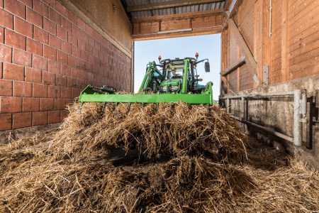 Sticky manure and full grapples of silage are easily handled with the M-Series Loader