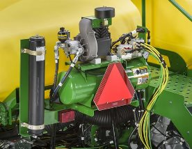 Accumulator is mounted near the air compressor to absorb any spikes of pressure