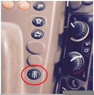 Compresseur d'air est engagé à l'aide du bouton situé sur l'accoudoir