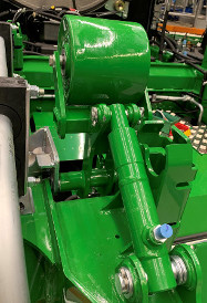 Tendeur de courroie hydraulique pour dispositif de traitement d'épis (code8381)