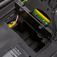 Compartiment de rangement avec couvercle sous le siège