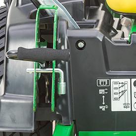L'axe de réglage de la hauteur de coupe sert également d'outil de réglage de la voie.