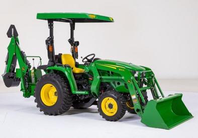 Pelle rétro montée sur un tracteur