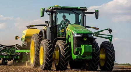 Tracteur avec extensions pour roues jumelées à l'avant