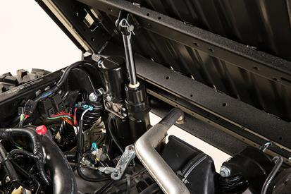 Trousse de relevage électrique de caisse de chargement en position complètement relevée