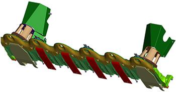 Les patins (en rouge) comprennent des plaques d'usure Hardox afin d'accroître leur résistance.