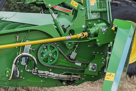 Tension chain on feed auger