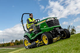 X949 Tractor mowing with 152-cm (60-in.) HC Mower Deck