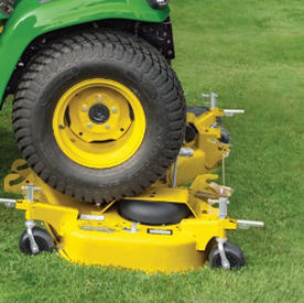 Two-wheel drive (2WD)- tractor driving onto high-capacity mower deck