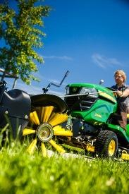 Front broom with debris catcher on X300 Series Tractor