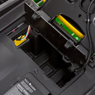 Storage compartment with cover located under seat