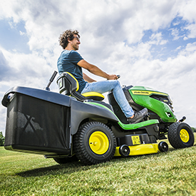 X167R Tractor mowing lawn