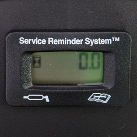 Hour meter with service-reminder feature