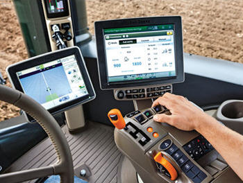Tractor cab with the GreenStar™ 3 2630 and 4600 CommandCenter™ displays