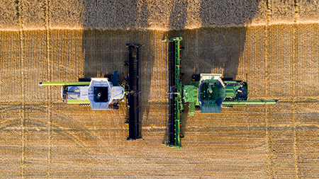 Field test validation with PAMI against CLAAS® and MacDon