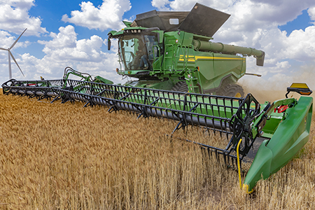 X Series harvesting wheat