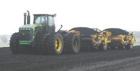 Scrapers hauling coal