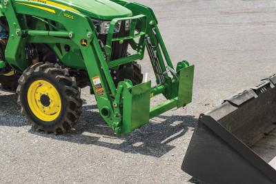 Skid steer carrier adapter