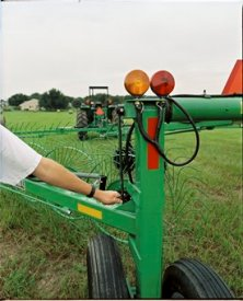 A crank aids the windrow width adjustment