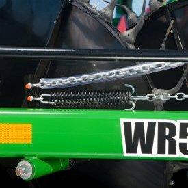 Dampening spring allows wheels to float