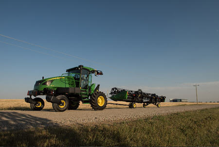 1400D integrated slow-speed transport system behind W170 Windrower