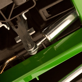 Shock absorber dampens movement of control levers