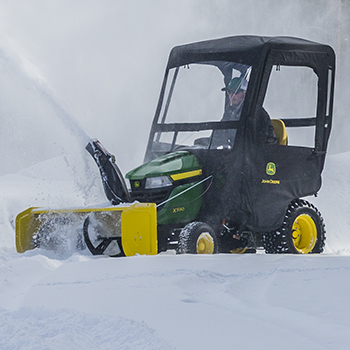 X590 Tractor shown with optional snow blower and weather enclosure