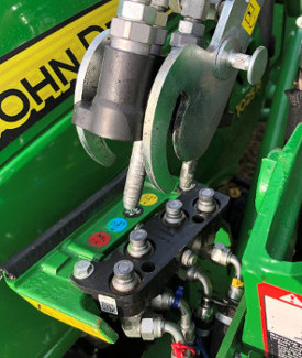 Align the loader side of hydraulic system with the fixed tractor section
