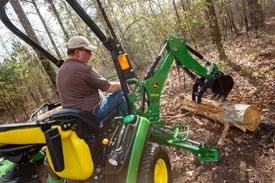 Lift heavy logs with 260B Backhoe