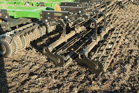 Distribute soil during spring tillage