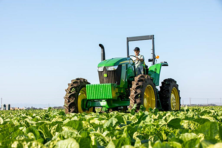 6EH Tractor operating in the field