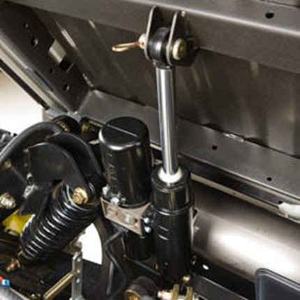Cargo box lift kit installed on a vehicle -– in the full-up position