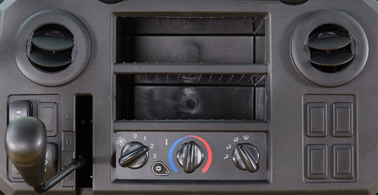 HVAC controls and vents on the dash