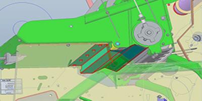 Skyddsplatta för tillsatser (rödmarkerad) under nätsystemets gummirulle